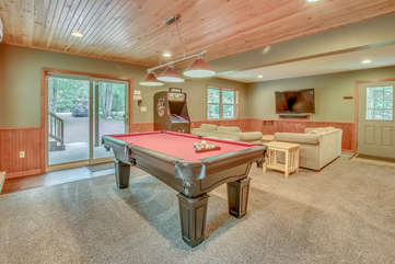 Game Room with Pool Table and Arcade Game