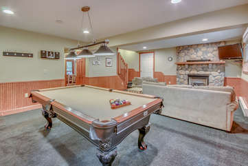 Downstairs Game Room, with Pool Table, Couches, and a Fireplace.