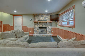 Downstairs TV Area in Game Room with Fireplace.