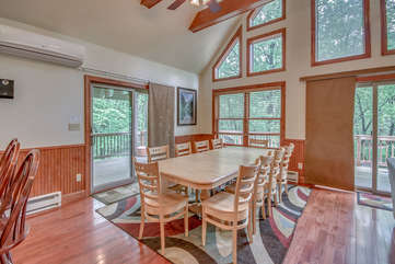 Dining Table and Chairs, with Sliding Glass Door to the Outdoor Patio.