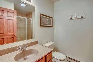 Bathroom with Sink, Mirror, Toilet, and Shower.