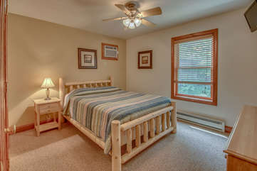 Bedroom with One Bed, Nightstand, Drawer Chest, Ceiling Fan, and TV.