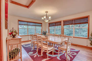Dining Table with Eight Chairs, Ceiling Lamp, and Windows.