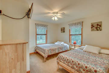 Bedroom with Two Beds, Nightstand, Ceiling Fan, and TV.