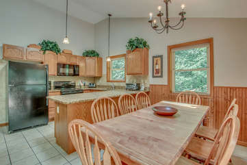Picture of the table and chairs, refrigerator, microwave, and oven in the kitchen of this Lake Harmony rental.