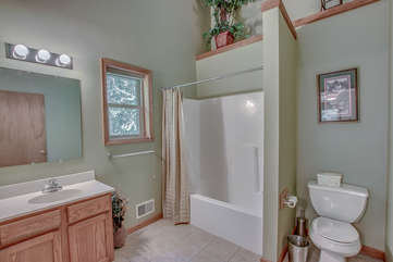 This Lake Harmony rentals master bathroom, with shower, toilet, and double sink.