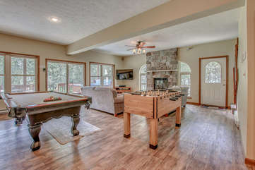 Pool Table, Foosball Table, Couches, Fireplace, and TV.