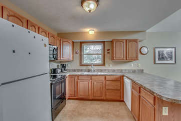 Kitchen with Counter, Refrigerator, and Dishwasher in our Towamensing Trails Vacation Rental.