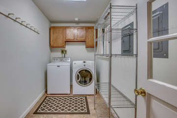 Laundry Room, with Washer, Dryer, and Drying Rack.
