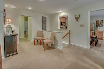 Picture of the Entryway to the Upper Floor, Two Chairs, and Drawer Chest.