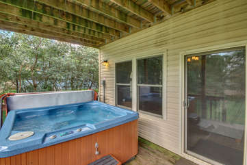Hot Tub with Water Running on the Deck of our Towamensing Trails Vacation Rental.