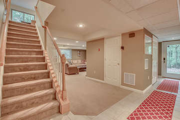Picture of the Stairs with a View of the Living Room.