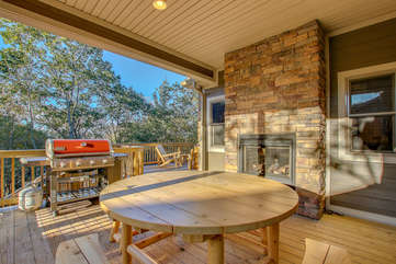 Grill, Table, and Fireplace on the Deck of our Poconos Luxury Rental