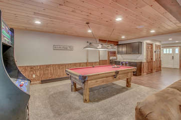Game Room with Pool Table and Arcade Machine