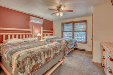 Bedroom with Two Beds, Ceiling Fan and Dresser