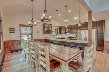 Kitchen with Table, Chairs, and Refrigerator at our Poconos Luxury Rental