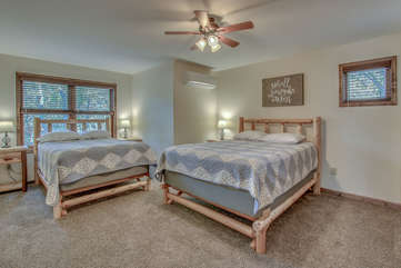 Spacious Bedroom with Two Beds and Ceiling Fan