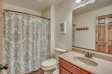 Bathroom with Sink, Toilet and Shower with Curtain
