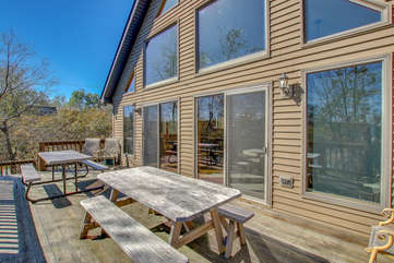 Spacious Deck Attached to Poconos Lake Rental with Three Tables.