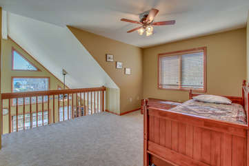 Upstairs Loft Features Wooden Bed and Plenty of Space.