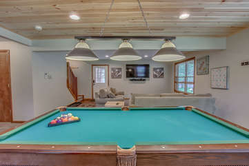 basement with pool table and couches