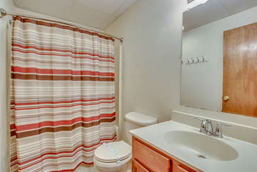 bathroom with single sink and nearby shower