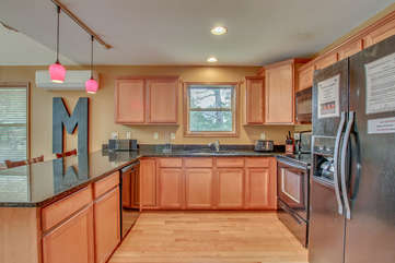 kitchen with fridge and sink nearby