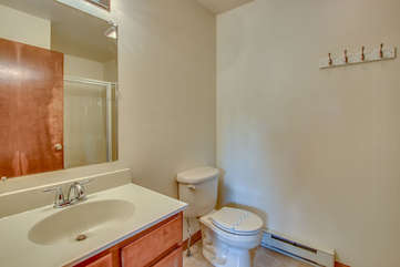 white bathroom with toilet and nearby sink
