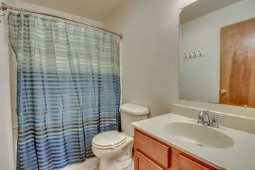 bathroom with sink and blue shower curtain