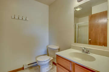 bathroom with toilet and nearby sink