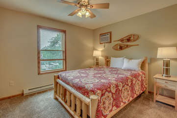 bedroom with single bed and snowshoes on wall