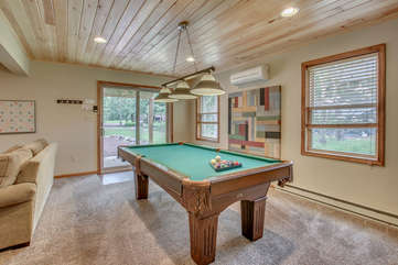 basement with pool table and nearby sliding door
