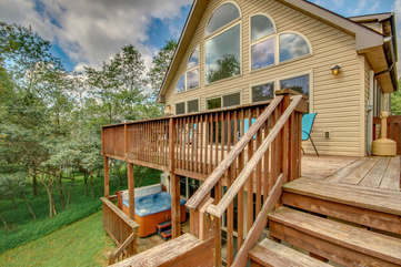 Lateral View of the Upstairs and Downstairs Deck, Patio Chairs, and Hot Tub.