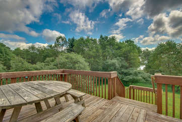 Picnic Table on Upstairs Deck with Forest View of our Towamensing Trails Vacation Rental.