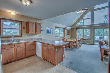 Kitchen Counter, Dining Table, Chairs, and a Couch in our Towamensing Trails Vacation Rental.
