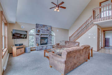 Living Room, Couches, Coffee Table, Fireplace, TV, Ceiling Fan, and Stairs.