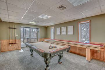 Spacious Game Room Features Pool Table and Shuffle Board.