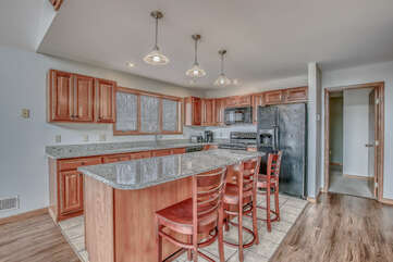Large Kitchen with a Beautiful Island and Chairs.