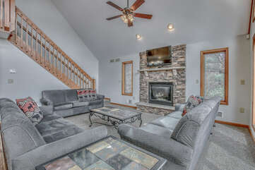 Enjoy Three Large Couches and a Fire Place in Living Room.