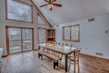 Dining Room Featuring Large Windows and Kitchen Table.