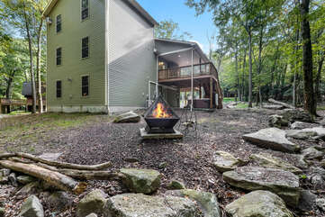 Outdoor fire pit of this luxurious Poconos vacation rental.