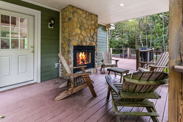 Outdoor fireplace and chairs in our Pocono Getaway Rental