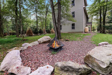 Fire Pit in Yard with Side View of Home