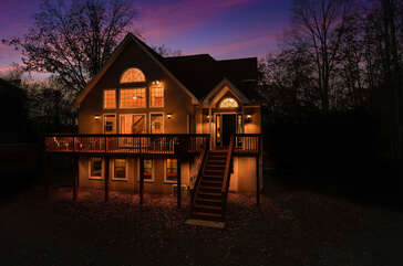 Front view at night of Wolf Run Lake Vacation Rental