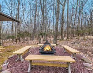 Outdoor Seating Area with Benches and Fire Pit.