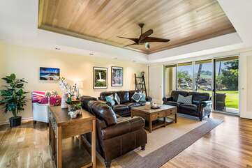 Living Room with Sofa, Ceiling Fan, and Sliding Doors to the Lanai