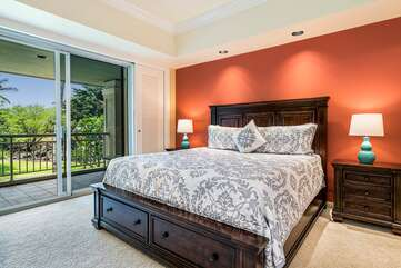 Bedroom with Large Bed and Sliding Doors to the Private Lanai