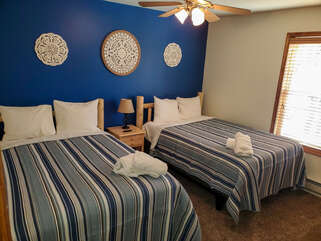 Two beds in a blue room