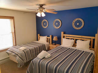 Blue bedroom with two beds
