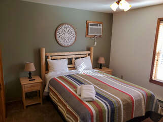 Single bed with multicolored comforter